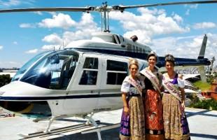 Rainha e Princesas da Festa da Uva 2019 sobrevoam Caxias do Sul em passeio de helicóptero